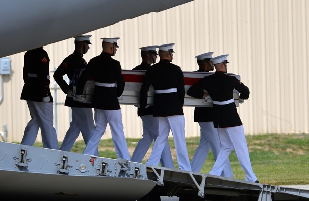 On Sept 14, 2012, US Marines carry a casket during a ceremony at Joint Base Andrews in Maryland transferring the remains of the four Americans killed in an attack in Benghazi, Libya. Credit: AFP/Getty Images