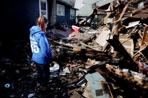 Kate Traina, 14, looks over the rumble of her grandparents house in Staten Island, N.Y., Friday, Nov. 2, 2012. (Seth Wenig / AP Photo)